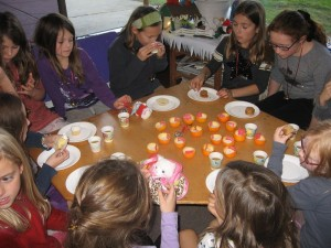 After making tangerine candles, we drank apple-cider and ate muffins and cookies while listening to the story.
